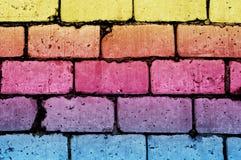 难看的东西与另外的颜色块的砖墙纹理 免版税图库摄影