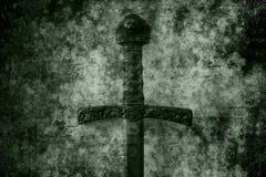 难看的东西剑背景 免版税库存照片