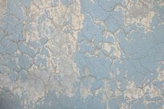 难看的东西和老被绘的蓝色墙壁 免版税库存照片
