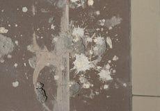 难看的东西纹理-肮脏飞溅油漆和膏药在抽象设计的,葡萄酒作用老地板背景 库存照片