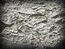 难看的东西自然参差不齐的粗砺的石头墙壁纹理  免版税库存图片