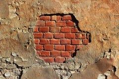 难看的东西被绘的红砖墙壁背景纹理 免版税库存照片