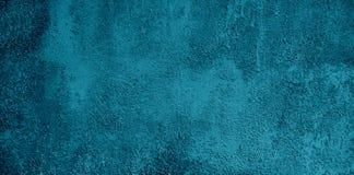 难看的东西装饰蓝色宽银幕背景 库存照片
