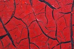 难看的东西金属表面-宏指令11上的破裂的红色油漆 免版税库存照片
