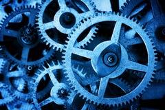难看的东西齿轮,嵌齿轮转动背景 工业科学,钟表机构,技术 免版税图库摄影
