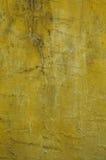 难看的东西黄色墙壁纹理 免版税库存图片