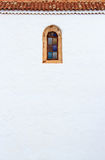 黄雀色样式教会的墙壁和窗口在劳利瓦, Fuerteve 免版税库存照片