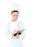 雄心勃勃的剪贴板厨师文字年轻人 库存照片