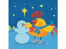 雄鸡在圣诞前夕晚上雕刻雪人 库存照片
