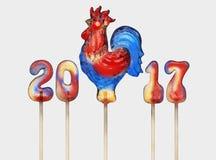 雄鸡棒棒糖 3D回报,新年设计的模板 库存照片