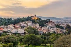 雅典市全国观测所在若虫小山顶部在Thissio,希腊 日落 免版税库存照片