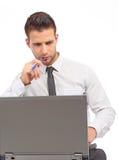 集中笔记本的生意人 免版税库存图片