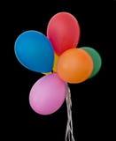 集会有被隔绝的银色串的,黑背景气球 免版税图库摄影