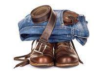 集合包括的牛仔裤传送带和袋子 免版税库存照片