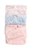 集合妇女的棉花气喘折叠和放置在彼此顶部 图库摄影