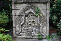 雕刻在岩石的巴厘岛样式 库存照片