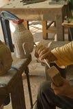 雕刻收割siem石头 图库摄影