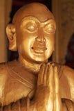 雕刻木头的菩萨 免版税图库摄影