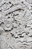 雕刻石墙 免版税库存照片