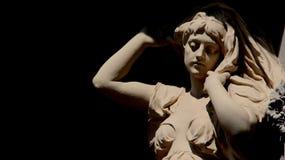 雕塑和艺术少妇有黑背景 库存图片