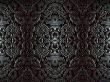 雕刻在与黑白的花纹花样的木头 免版税图库摄影