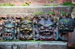 雕刻恶魔面具尼泊尔样式在加德满都 库存图片