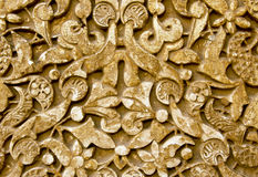 雕刻从阿尔罕布拉宫宫殿的古老石墙在格拉纳达西班牙 免版税库存图片