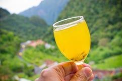 雨披-马德拉岛海岛,葡萄牙传统饮料  图库摄影