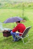 从雨的保护火盆 免版税图库摄影