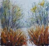 从雪下面的黄色草在春天森林 免版税图库摄影
