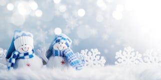 雪人和圣诞节装饰 免版税库存图片