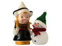 雪人和女孩 免版税图库摄影