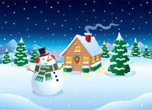 雪人和客舱冬天雪场面 库存照片