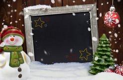 雪人和雪花圣诞快乐 免版税库存照片