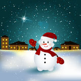 雪人在村庄 免版税库存图片