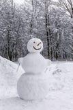 雪人在森林里 免版税图库摄影