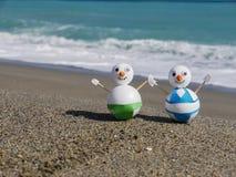 雪人海滩假期 免版税库存照片