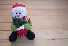 以雪人的形式长毛绒玩具 免版税库存图片