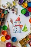 雪人被绘的树胶水彩画颜料和水彩 库存照片