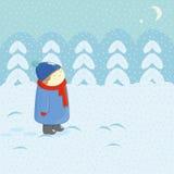 雪和孩子 库存图片