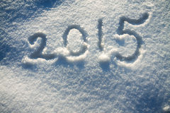 从雪和数字的新年的和圣诞节背景 免版税图库摄影
