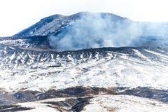 雪在阿苏山 库存图片