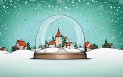 雪地球的村庄与村庄风景在背景中 免版税库存图片