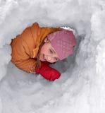 雪孔的女孩 库存图片