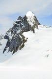 雪山峰 免版税库存照片