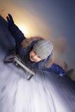 雪撬的愉快的男孩 免版税图库摄影
