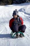 雪撬的男孩 免版税库存照片