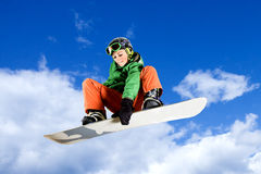 雪板跳跃 库存照片