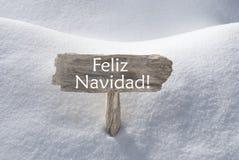 雪标志Feliz Navidad手段圣诞快乐 免版税库存照片