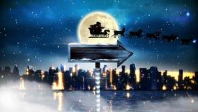 雪橇的圣诞老人与驯鹿飞行和箭头签署有月亮的夜城市 库存例证